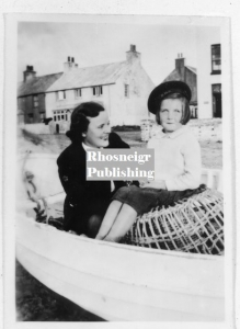 rtan-p036a-spc433-girl-sat-on-lobster-pot-rhosneigr.jpg